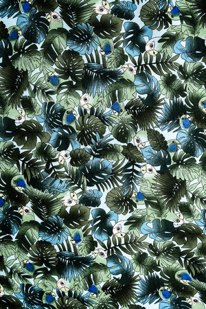 tiki party: texture fabric Vintage Hawaiian parrot and leaves for background Stock Photo