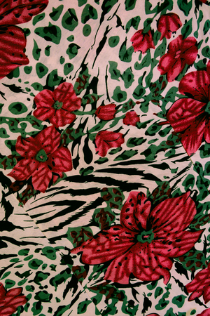 mixed forest: texture fabric of tiger prints and decorative roses