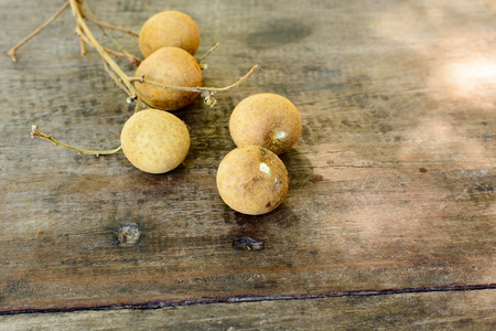 black seed: Longan Fresh show the white meat with black seed was placed on a wooden background Stock Photo