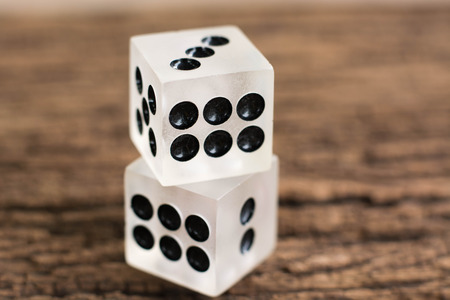 two dices on wood table Stock Photo