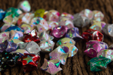 paper fold: colorful of paper fold christmas stars on old wood surface