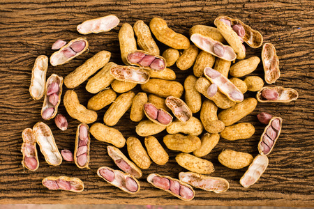 ground nuts: fresh ground nuts on old wooden background