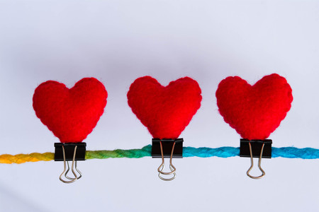 linked together: Connected group concept as many different ropes tied and linked together as an unbreakable chain as a community trust and faith metaphor. And red hearts above many Stock Photo