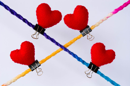 linked together: Connected group concept as many different ropes tied and linked together as an unbreakable chain as a community trust and faith metaphor. And red hearts Stock Photo