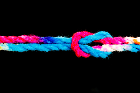 Connected group concept as many different ropes tied and linked together as an unbreakable chain as a community trust and faith metaphor and learning Foto de archivo