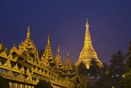 Shwedagon Pagoda Paya Temple shining at night in Yangon, Myanmar  Burma  Asia  写真素材