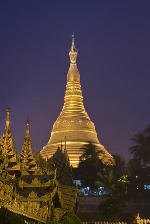 Shwedagon Paya Temple shining at night in Yangon, Myanmar  Burma  Asia photo