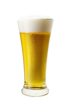 Glass of cool light beer close-up with froth isolated on a white background photo