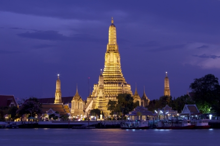 Twilight view Pra Prang of Wat Arun, Famous Thai temple across Chao Phraya River during sunset, Bangkok, Thailand
