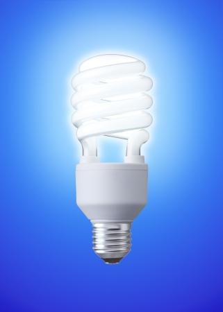 white energy saving bulb, Illuminated light bulb, CFL bulb, Realistic photo image on blue background