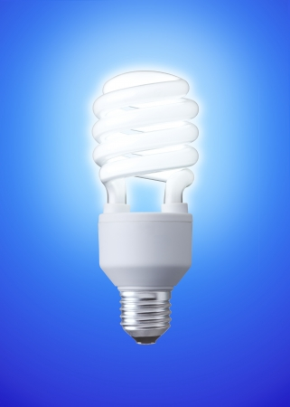 white energy saving bulb, Illuminated light bulb, CFL bulb, Realistic photo image on blue background