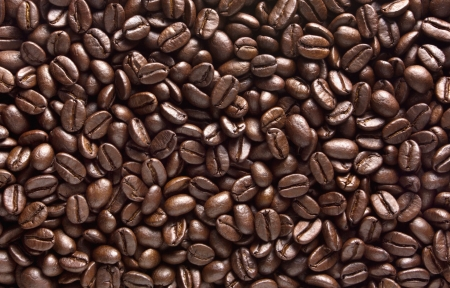 coffe beans: Roasted brown coffee beans, can be used as a background and texture Stock Photo