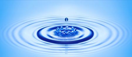water drop created ripple and splash in crown shape 写真素材