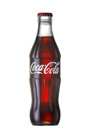 Bangkok, Thailand - JUNE 20, 2014  Coca-Cola Classic in a glass bottle Isolated on white Background  Coca Cola, Coke is the most popular carbonated soft drink beverages sold around the world
