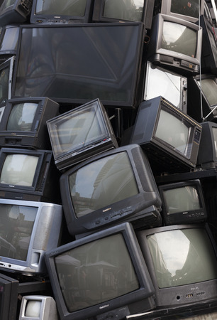 digital television: old television garbage, rubbish TV, electronic junk can be recycle. Pile of broken television stacked for disposal, logos and brand names have been removed. Great for recycle and environmental themes.