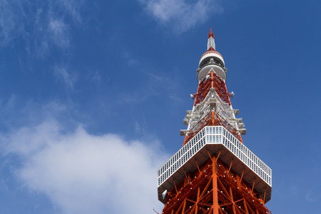 steel tower: Tokyo tower is the first iron steel building construction for broadcast and radio in Japan. The landmark of Japan in blue sky Stock Photo