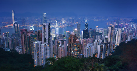 Victoria Peak, city Skyline in Hong Kong bay. Night view of Cityscape modern office buildings from the Peak