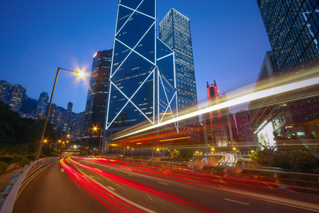 Business District Concept - Traffic trails on the Cityscape modern office buildings in central Hong Kong. Car light trails on city Skyline in downtown. Zdjęcie Seryjne