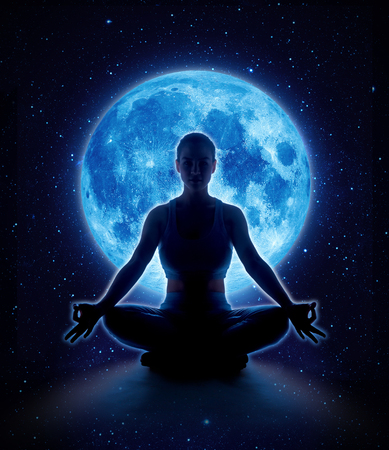 Yoga woman in full blue moon and star. Meditation girl sitting in lotus pose under moonlight in dark night sky
