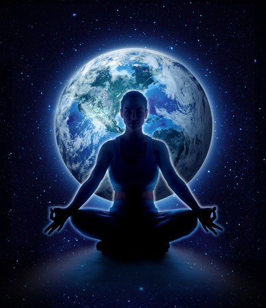 Yoga woman on the world. Meditation girl itting in lotus pose on planet earth and star in dark night sky, 版權商用圖片