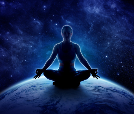 Yoga woman on the world. Meditation girl itting in lotus pose on planet earth and star in dark night sky, Moon original image from NASA.gov