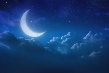 half blue moon behind cloud over sky and star at night. Outdoors at night. lunar shine moonlight over cloudy at nighttime with copy space background for headline text and graphic design. Elements of this image furnished by NASA