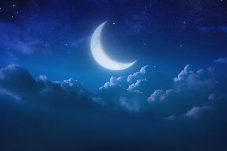 half blue moon behind cloud over sky and star at night. Outdoors at night. lunar shine moonlight over cloudy at nighttime with copy space background for headline text and graphic design.