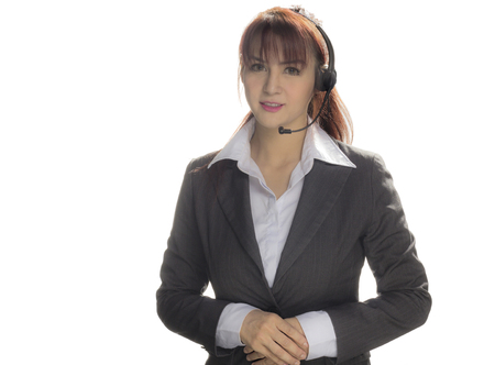 Call center woman with headset Studio shot. Business woman smile with headset isolated on a white background with copyspace. Customer Service Agent are smiling during a telephone conversation.   版權商用圖片