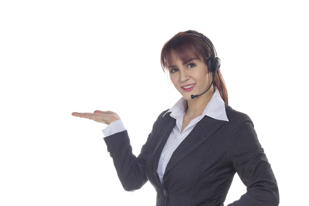 Call center woman, smiling business woman, customer Service Agent with headset isolated on a white background. Customer Service Agent are showing open hand palm  during a telephone conversation.