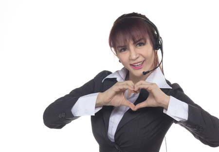 Call center woman, smiling business woman, customer Service Agent with headset isolated on a white. Customer Service Agent are showing  in love sign, heart shape during a telephone conversation. Zdjęcie Seryjne