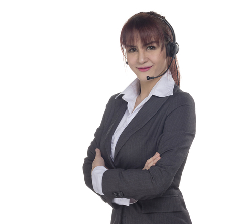 Call center woman with headset Studio shot. Business woman smile with headset isolated on a white background with copyspace. Customer Service Agent are smiling during a telephone conversation.    Zdjęcie Seryjne