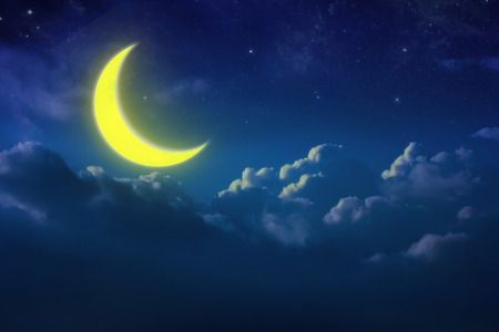Half yellow moon behind cloud over sky and star at night. lunar shine moonlight over cloudy with copy space background for headline text or graphic design. Elements of this image furnished by NASA