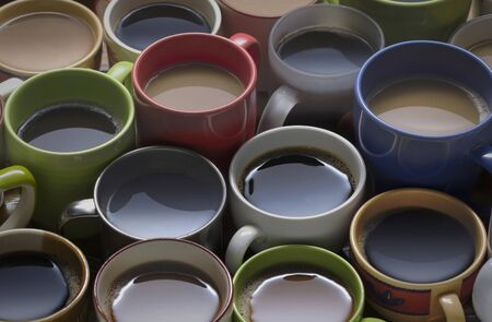 coffee time - lots of coffee cup in different cups. coffee lover - many cups of coffee on wooden table good background for text or graphic design Zdjęcie Seryjne