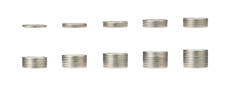 pile of silver coins stack and growing money graph on 1 to 10 rows of coin isolated on white background with clip path. Income, profits, finance, Investment, Interest and Saving money concept. Zdjęcie Seryjne