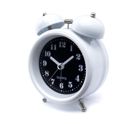 white analog alarm clock. Time concept with Old fashioned alarm clock or watch on white background. Metal bell vintage alarm clock in retro style isolated with clip path - easy to die cut out Zdjęcie Seryjne