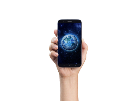 World in hand - hand holding mobile phone or smart phone on Planet Earth background. Life style, Technology, communication, connection, Environment, Climate issues and Saving the planet concept
