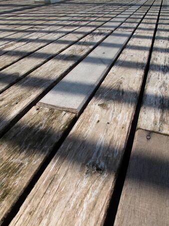 Perspective of outdoor-wood -floor in daytime.