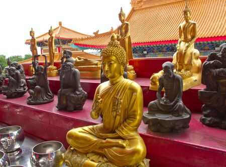 Budha statue with many asian god.