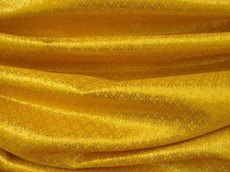 Gold textile with Asian style pattern.