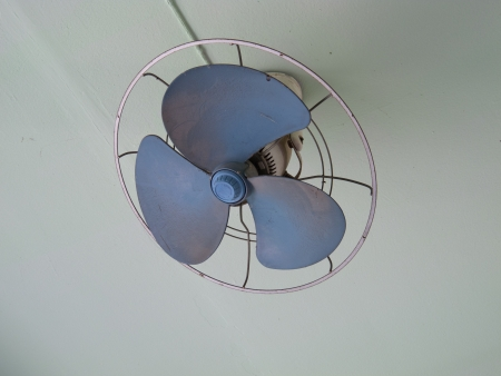 An old fan on ceiling photo