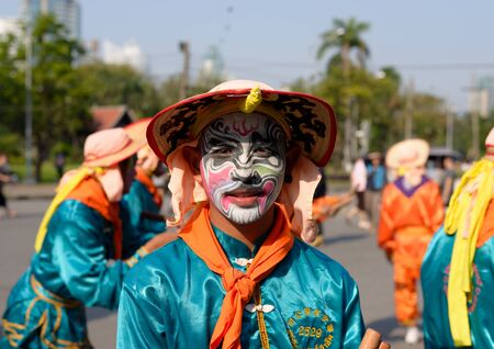 lumpini: Bangkok, Thailand - January 17, 2015 An unidentified man with painting face and custom in Chineses style at Lumpini Park, when the day of Thailands travel festival. Editorial