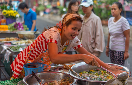 Bangkok, Thailand - January 25, 2015 Unidentified woman is selling foods on street in the morning at Houay Kwang area.
