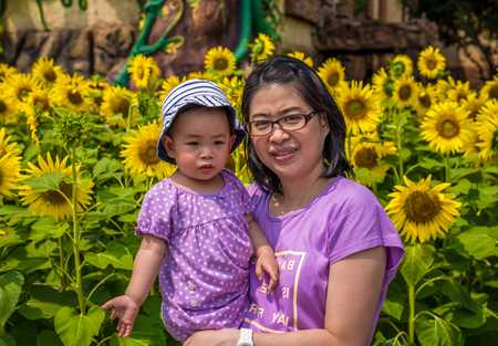 theme park: Pathumthani, Thailand - Mar 8 , 2015: Unidentified mother and daughter at Dream World Theme Park. Editorial