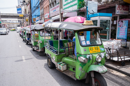 Bangkok, Thailand - June 8, 2015 Line of Tuk Tuk, tricycle taxi are waiting for passenger in area of Saphan Khwai, an old downtown near Jatujak market. photo