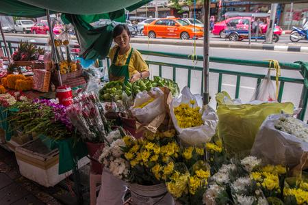flower seller: Bangkok, Thailand - June 8, 2015 Unidentified flower seller on side walk in area of Saphan Khwai, an old downtown near Jatujak market. Stock Photo
