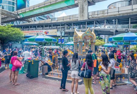 ashram: Bangkok, Thailand - June 19, 2015 Unidentified tourists come to warship Lord Brahma Shrine is the Ashram located the Grand Hyatt Erawan hotel.