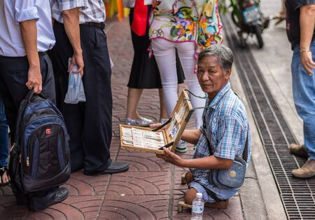 Bangkok, Thailand - July 15, 2015 Unidentified disability man is selling lotterry in area of Yaowarat or Thailands China Town