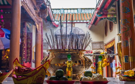 temple burn: Bangkok, Thailand - July 15, 2015 Joss stick pot at Wat Lengnoeiyi of Yaowarat or China Town of Thailand. This temple is very famous for Thai-Chinese people.