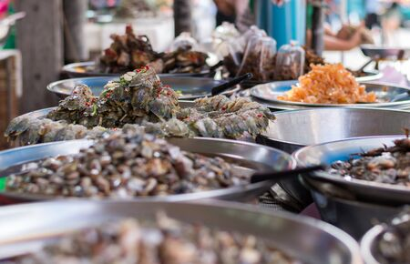 Variety of marinate raw food for sell in area of Yaowarat or Chinatown of Thailand.