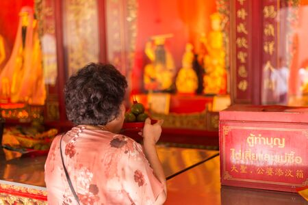 lengnoeiyi: Bangkok, Thailand - July 15, 2015 Unidentified old woman is praying at  Wat Lengnoeiyi of Yaowarat or China Town of Thailand. This temple is very famous for Thai-Chinese people. Editorial